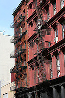 Fire escapes on building downtown, New York City, USA