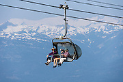 The Solar Coaster Express chairlift carries hikers to the Overlord Trail on Blackcomb Mountain in the glacier-clad Coast Range, British Columbia, Canada. The Resort Municipality of Whistler is popular for year-round  outdoor sports aided by gondolas and chair lifts.