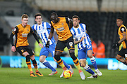 Hull City midfielder Mohammed Diame (17) and Brighton central defender, Connor Goldson (17) during the Sky Bet Championship match between Hull City and Brighton and Hove Albion at the KC Stadium, Kingston upon Hull, England on 16 February 2016.