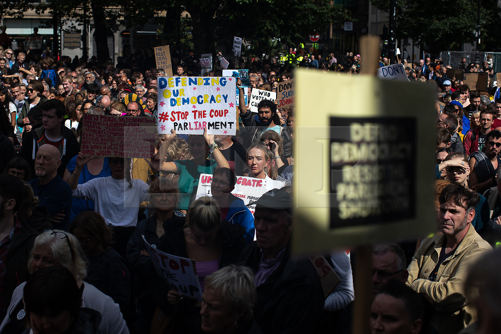"""© Licensed to London News Pictures. 31/08/2019. Manchester, UK. A placard reading """"Defending our democracy stop the coup """" . Thousands attend a pro EU demo in Albert Square in Manchester City Centre , with objections raised to the Prime Minister Boris Johnson's intention to prorogue Parliament in the run up to Britain's planned Brexit deadline . Photo credit: Joel Goodman/LNP"""