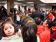22 FEBRUARY 2011 - PHOENIX, AZ:  Alexi Acosta, (CQ) 9 months, was one of the children to demonstrate in favor of immigrants' rights at the State Capitol in Phoenix Tuesday. Hundreds of people including supporters of immigrants' rights, supporters of border defense, motorcycle riders and members of the Tea Party, converged on the capitol to express their views on bills.     PHOTO BY JACK KURTZ