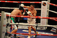 featherweight WBC world title eliminator.<br /> Lee Selby of Wales (r) v Romulo Koasicha of Mexico' The second coming'  boxing event at the Motorpoint Arena in Cardiff, South Wales on Sat 17th May 2014. <br /> pic by Andrew Orchard, Andrew Orchard sports photography.