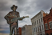 A life-size statue of the famed country music legend, Hank Williams stands where his career started, in the center of the Riverfront Entertainment District on 3rd March 2020 in Montgomery, Alabama, United States. Despite his brief life, he died aged 29 with a history of alcoholism and prescription drug abuse, he is regarded as one of the most significant and influential American singers and songwriters of the 20th century. Williams recorded 35 singles that reached the Top 10 of the Billboard Country & Western Best Sellers chart, including 11 that ranked number one.