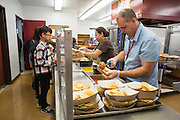 Milpitas Unified School District Transportation, Grounds, Plumbing, and Safety Supervisor Roger Silveira shadows Rancho Middle School Satellite Kitchen Operator Idalia Campos, not pictured, during Classified School Employee Week at Rancho Middle School in Milpitas, California, on May 19, 2016. (Stan Olszewski/SOSKIphoto)