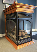 Empire Comfort Systems has a separate building which is used as a showroom for their gas stoves and fireplaces.  This three-sided, vent-free peninsula unit - and the wooden mantle - is made at the factory. The Belleville manufacturing firm is celebrating its 80th anniversary.