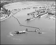 """Ackroyd 14801-2 """"Port of Portland. Aerial of dredge off Swan Island dry dock. August 25, 1967"""" (dredge filling Swan Island Industrial Park in Mocks Bottom with fill from Willamette River in front of dry dock)"""