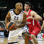 Anadolu Efes's Alfred Jamon Lucas (L) and Olympiacos's Kostas Papanikolaou (R) during their Turkish Airlines Euroleague Basketball playoffs Game 4 Anadolu Efes between Olympiacos at Abdi ipekci Arena in Istanbul, Turkey, Friday, April 19, 2013. Photo by Aykut AKICI/TURKPIX