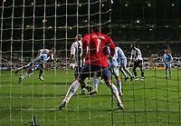 Photo: Andrew Unwin.<br /> Newcastle United v Celta Vigo. UEFA Cup. 23/11/2006.<br /> Newcastle's Steven Taylor (L) scores his team's second goal.