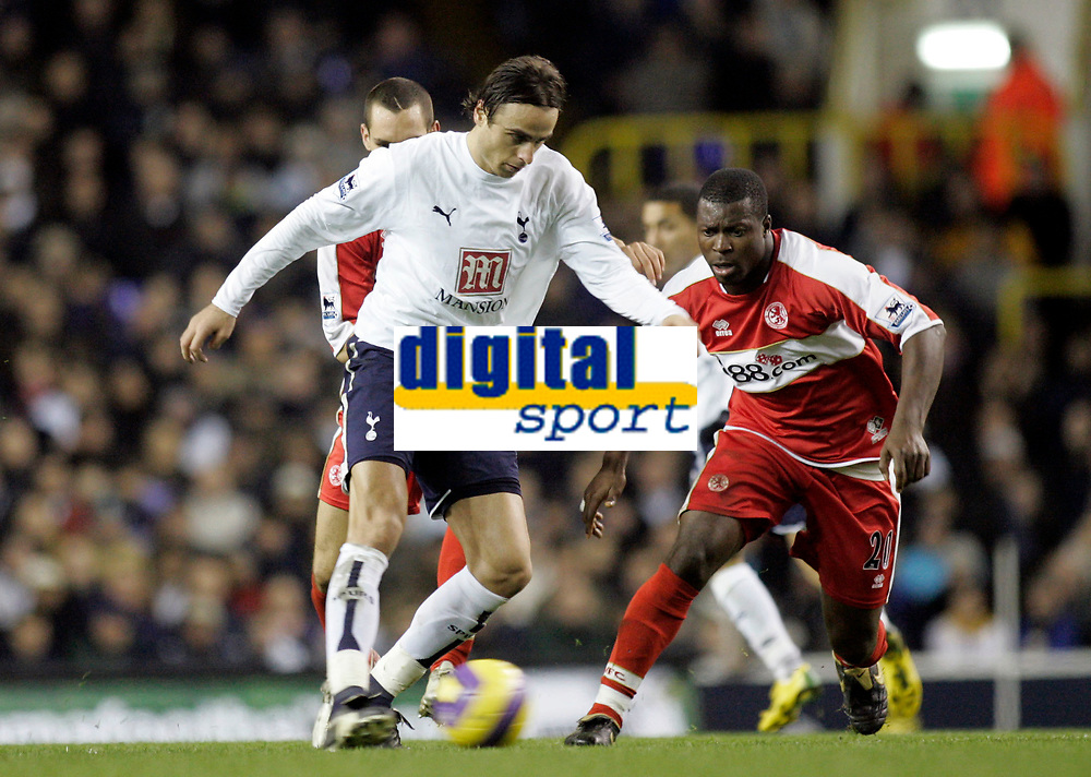 Photo: Marc Atkins.<br /> Tottenham Hotspur v Middlesbrough. The Barclays Premiership. 05/12/2006. Dimitar Berbatov (L) of Spurs in action with Yakubu of Boro.