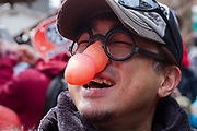 A Japanese man wears joke spectacles with a large penis for the nose at the Kanamara matsuri or festival of the Steel phallus Kawasaki Daishi, Kawasaki, Kanagawa, Japan. Sunday, April 2nd 2017. The Kanamara Penis festival takes place on the first Sunday of April and celebrates the local legend of a penis eating demon who was defeated after being tricked into biting a steel phallus. The festival is popular with Japan's gay community and now uses its notoriety to raise money for HIV and AIDS charities. It is also wildly popular with foreign and Japanese.tourists.
