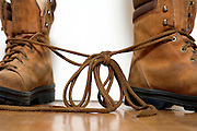 boots with the laces tied together