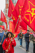 Members of the Communist Party of Great Britain show solidarity - he May Day March from Clerkenwell Green ending with a rally in Trafalgar Square - against cuts and anti 'Trade Union laws. It was supported by several trade unions including UNITE, PCS, ASLEF, RMT, TSSA, NUT, FBU, GMB and UNISON as well as the Peoples Assembly, Pensioners' organisations and organisations representing migrant workers & communities.
