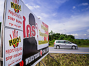 09 JULY 2013 - PATTANI, PATTANI, THAILAND:  Billboards on a highway in Pattani, Thailand, urging insurgents not to carry out attacks against the Thai government during the Muslim holy month of Ramadan. Muslim insurgents have been fighting in Thailand's southern three provinces of Pattani, Narathiwat and Yala. The provinces are Muslim majority.    PHOTO BY JACK KURTZ