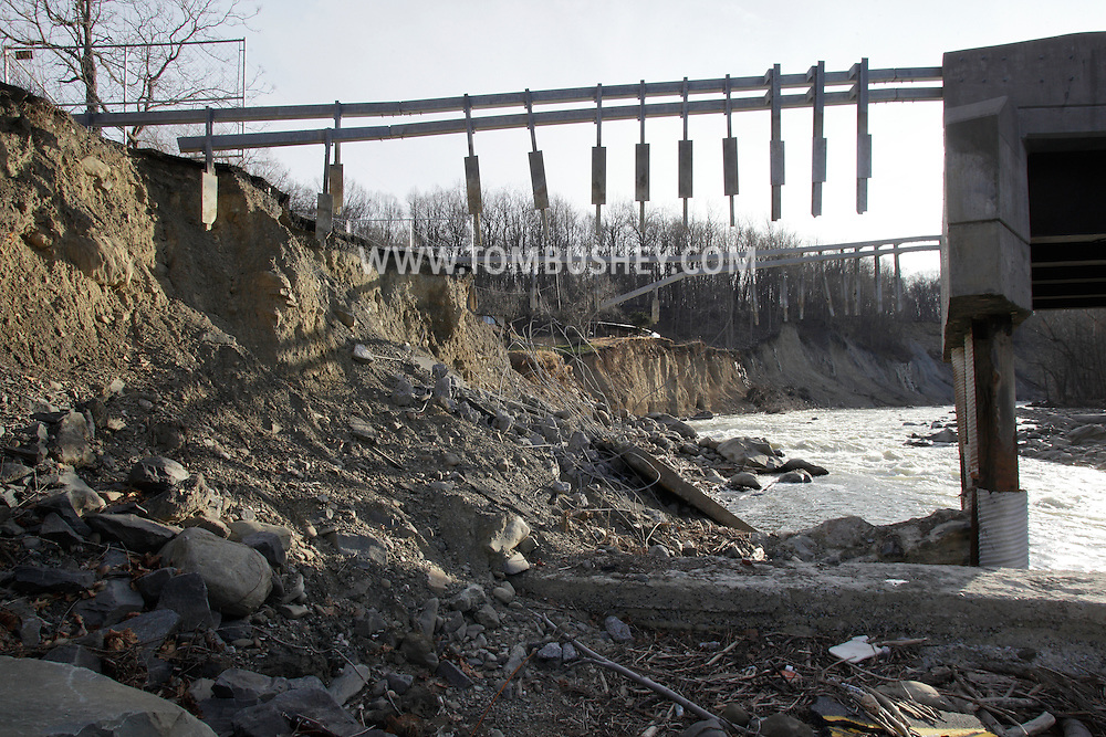 New Windsor, New York  - Water from the Moodna Creek destroyed part of this bridge carrying Forge Hill Road over the river during tropical storm Irene on Aug. 29, 2011. Pieces of the road surface can be seen among the rocks at the bottom of the frame. The photograph was taken on Dec. 29, 2011.