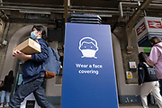Instruction that face masks or face coverings must be worn on all Tfl Transport for London services at Charing Cross Station under coronavirus lockdown on 1st July 2020 in London, England, United Kingdom. As the July deadline approaces and government will relax its lockdown rules further, the central London remains very quiet, while some non-essential shops are allowed to open with individual shops setting up social distancing systems.