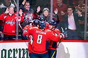 Washington Capitals players and fans celebrate John Carlson's go-ahead goal in the third period against the Boston Bruins at Capital One Arena on December 11, 2019.