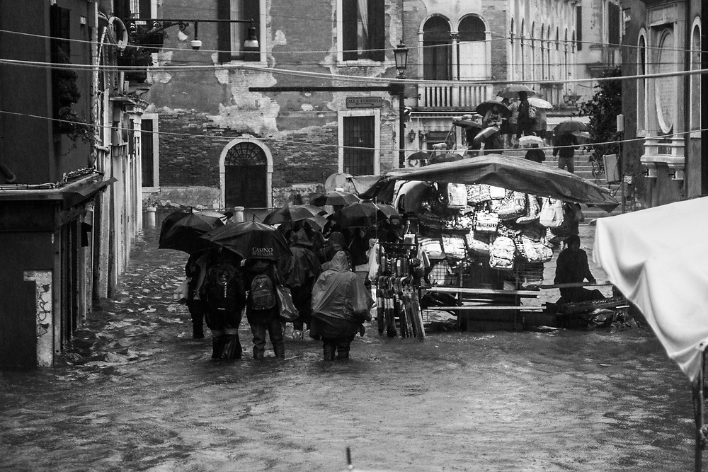 Venice, Italy. 29 October, 2018. People walk through Strada Nova during the high tide on October 29, 2018, in Venice, Italy. This is a selection of pictures of different areas of Venice that the press has not covered, were resident live and every year they have to struggle with the high tide. Due to the exceptional level of the 'acqua alta' or 'High Tide' that reached 156 cm today, Venetian schools and hospitals were closed by the authorities, and citizens were advised against leaving their homes. This level of High Tide has been reached in 1979. © Simone Padovani / Awakening / Alamy Live News