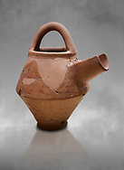 Hittite terra cotta side spout with stainer basket handles pitcher . Hittite Period, 1600 - 1200 BC.  Hattusa Boğazkale. Çorum Archaeological Museum, Corum, Turkey. Against a grey bacground. .<br />  <br /> If you prefer to buy from our ALAMY STOCK LIBRARY page at https://www.alamy.com/portfolio/paul-williams-funkystock/hittite-art-antiquities.html  - Hattusa into the LOWER SEARCH WITHIN GALLERY box. Refine search by adding background colour, place,etc<br /> <br /> Visit our HITTITE PHOTO COLLECTIONS for more photos to download or buy as wall art prints https://funkystock.photoshelter.com/gallery-collection/The-Hittites-Art-Artefacts-Antiquities-Historic-Sites-Pictures-Images-of/C0000NUBSMhSc3Oo