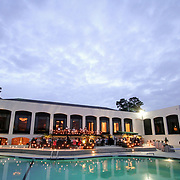 Forest Lake Club and pool is seen during a rehearsal dinner at dusk in Columbia, S.C.   ©Travis Bell Photography