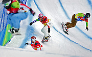 U.S. snowboarder Lindsey Jacobellis (bottom left, #3) runs in second place as the pack enters a turn and heads for a jump during the 2006 Winter Olympics Women's Snowboard-Cross Quarterfinals at Bardonecchia Friday February 17, 2006. Also pictured with Jacobellis are Swiss rider Mellie Francon (far left, in air), French rider Karine Ruby (center, #11) and Brazilian rider Isabel Clark Ribeiro (far right, #6). U.S. snowboarder and medal favorite Lindsey Jacobellis had a sizable lead over the other three riders in the final run and lost out on a gold medal when she fell trying to showboat off one of the final jumps on the course. Jacobellis had to settle for a silver medal instead with Swiss rider Tanja Frieden taking the gold and Canadian rider Dominique Maltais taking the bronze..(Photo by Marc Piscotty / © 2006)