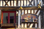 Classic timbered restauarant with signs. Le Champlain. Honfleur, Normandy, France. . Honfleur is especially known for its old port, characterised by its houses with slate-covered frontages, painted many times by artists, including in particular Gustave Courbet, Eugène Boudin, Claude Monet and Johan Jongkind, forming the école de Honfleur (Honfleur school) which contributed to the appearance of the Impressionist movement. .<br /> <br /> Visit our FRANCE HISTORIC PLACES PHOTO COLLECTIONS for more photos to download or buy as wall art prints https://funkystock.photoshelter.com/gallery-collection/Pictures-Images-of-France-Photos-of-French-Historic-Landmark-Sites/C0000pDRcOaIqj8E