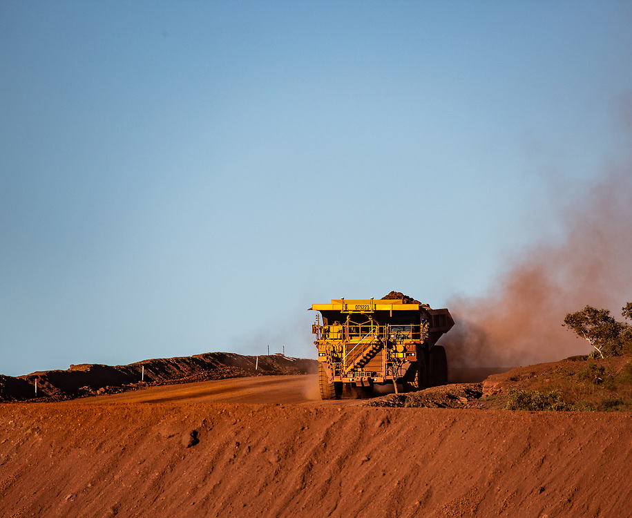 Iron ore haulage trucks at a mine site in the Pilbara region of Western Australia.