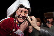 Ikhbal, the wife of the late Khan, is trying out make-up for the first time. The make-up was given away as a freebee by an itinerant trader..Inside Ikhbal's house - Ikhbal is the last wife of the deceased Khan. His two previous wives died in labor...Trekking through the high altitude plateau of the Little Pamir mountains, where the Afghan Kyrgyz community live all year, on the borders of China, Tajikistan and Pakistan.