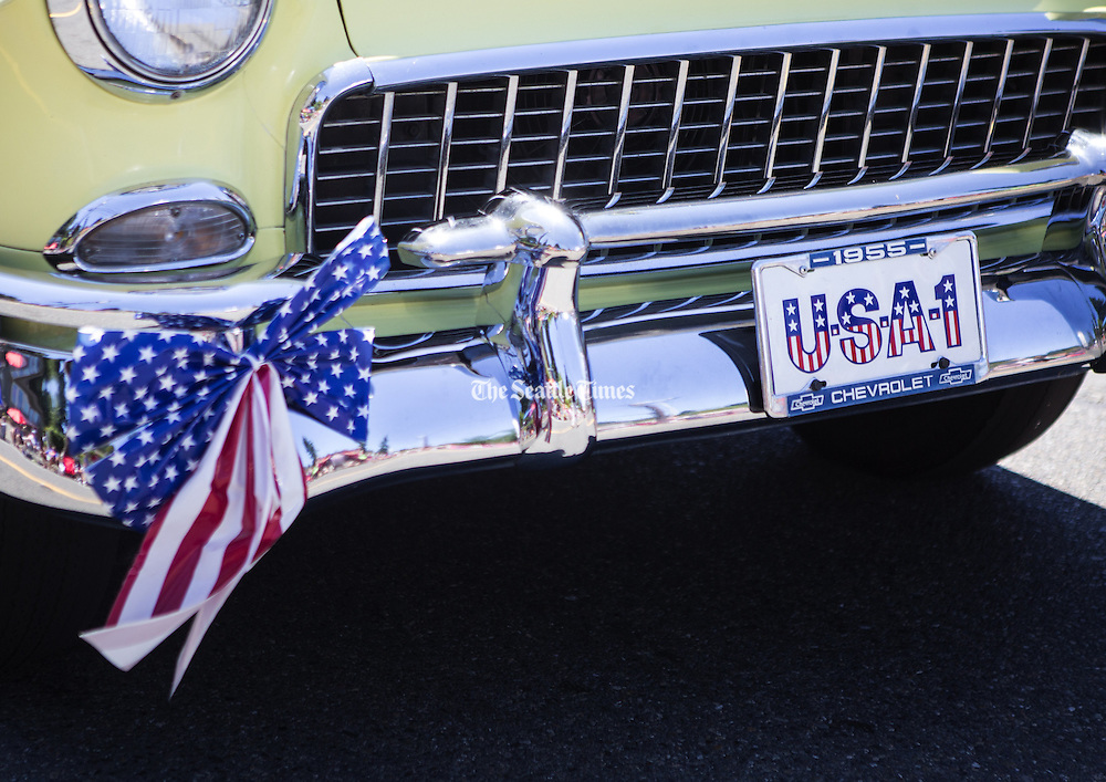 """A 1955 Chevrolet rolls by with """"USA-1"""" in the license plate holder during the annual Freedom Festival in Bothell on  July 4.<br /> <br /> Lindsey Wasson / The Seattle Times"""