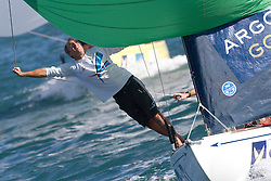 James Stagg prepares to drop the spinnaker for Ben Ainslie during the repechage of the Argo Group Gold Cup 2010. Hamilton, Bermuda. 8 October 2010. Photo: Subzero Images/WMRT