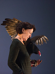 """© Licensed to London News Pictures. 06/05/2014. London, England. Pictured: Fiona Shaw performing with Inti, a six-year old Turkey Vulture (Cathartes aura). """"The Testament of Mary"""" performed by actress Fiona Shaw at the Barbican Theatre, London. Running from 1 to 25 May 2014. Directed by Deborah Warner based on the novel by Colm Tóibín. Photo credit: Bettina Strenske/LNP"""