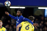 Michy Batshuayi of Chelsea (L) battles in the air with Christoph Zimmermann of Norwich City (R). The Emirates FA Cup, 3rd round replay match, Chelsea v Norwich City at Stamford Bridge in London on Wednesday 17th January 2018.<br /> pic by Steffan Bowen, Andrew Orchard sports photography.