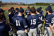 CARY, NC - FEBRUARY 23: Monmouth assistant coach Chris Collazo (5) talks to his players. The Monmouth University Hawks played the Saint John's University Red Storm on February 23, 2018 on Field 2 at the USA Baseball National Training Complex in Cary, NC in a Division I College Baseball game. St John's won the game 3-0.
