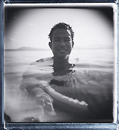 Portrait of a Filipino man smiling for the camera as he swims in the calm sea, Palawan Island, Philippines, Southeast Asia
