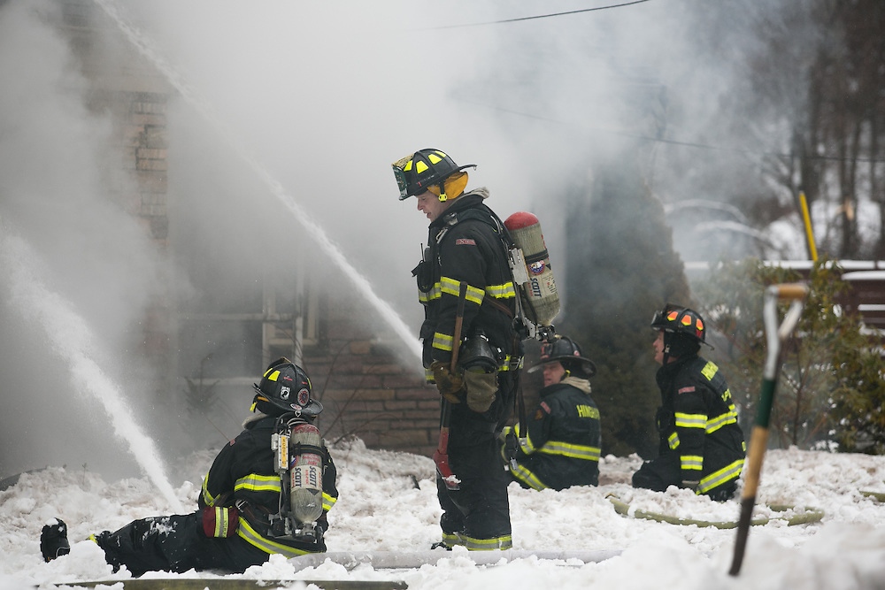 Hingham, MA 02/11/2013.Firefighters work at the scene of a 3 alarm house fire at 276 East St. in Hingham on Monday, February 11..Alex Jones / www.alexjonesphoto.com