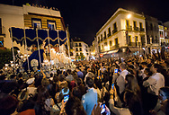 People waits for the passage of the procession from every possible viewpoint. Seville, Spain.