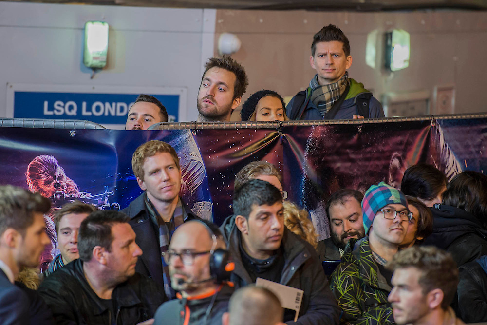 People seek any vantge point - The European Premiere of STAR WARS: THE FORCE AWAKENS - Odeon, Empire and Vue Cinemas, Leicester Square, London.