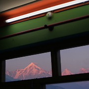 Hotel room with sunset view over Panchchuli Peaks. In the Himalaya.
