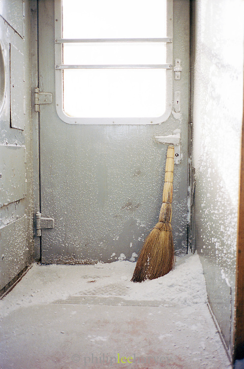 Brush used for clearing snow from the steps of the Trans Siberian railway, Siberia, Russia