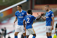 Brighton and Hove Albion defender Lewis Dunk (5), Brighton and Hove Albion defender Tariq Lamptey (2), and Brighton and Hove Albion defender Adam Webster (15) celebrate at full time during the Premier League match between Burnley and Brighton and Hove Albion at Turf Moor, Burnley, England on 26 July 2020.