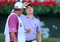 September 24, 2017 - Atlanta, GA, USA - Justin Thomas reacts to missing his birdie putt on the 18th green to finish at 11-under par, good enough to take home the FedEx Cup, but losing the Tour Championship to Xander Schauffele who made birdie on 18 to finish at 12-under par at East Lake Golf Club in Atlanta on Sunday, Sept. 24, 2017. (Credit Image: © Curtis Compton/TNS via ZUMA Wire)
