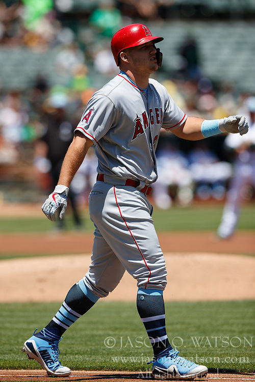 OAKLAND, CA - JUNE 17: Mike Trout #27 of the Los Angeles Angels of Anaheim walks to first base after he is hit by a pitch from Daniel Mengden (not pictured) of the Oakland Athletics during the first inning at the Oakland Coliseum on June 17, 2018 in Oakland, California. The Oakland Athletics defeated the Los Angeles Angels of Anaheim 6-5 in 11 innings. (Photo by Jason O. Watson/Getty Images) *** Local Caption *** Mike Trout