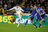 Gylfi Sigurdsson of Swansea city watches his shot go well wide of goal.  Barclays Premier League match, Swansea city v Chelsea at the Liberty Stadium in Swansea, South Wales on Saturday 17th Jan 2015.<br /> pic by Andrew Orchard, Andrew Orchard sports photography.
