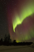 Aurora Borealis or Northern Lights over Finnmark, Norway, from the border between Norway and FInland.