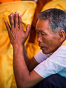 27 FEBRUARY 2015 - PONHEA LEU, KANDAL, CAMBODIA:  A man prays during a Buddhist ceremony in his village in Kandal province, Cambodia.   PHOTO BY JACK KURTZ