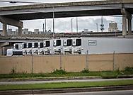 Refrigorator trucks outside of the New Orleans Coroner's Office.