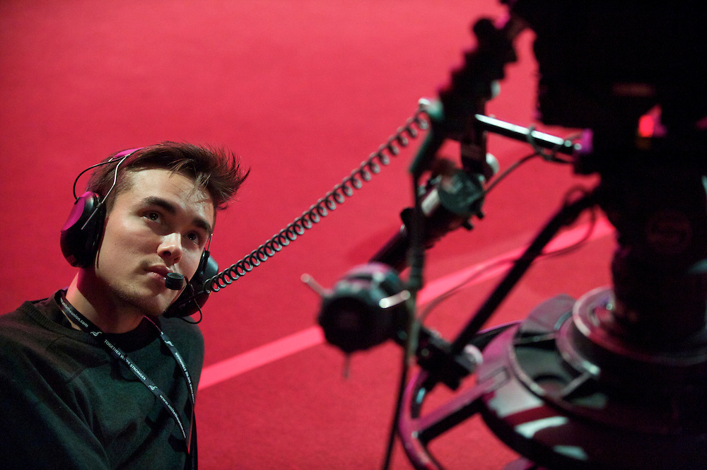 A television cameraman takes a break in the action during the Labour Party Conference in Manchester on 29 September 2010, the penultimate day of annual assembly.