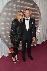 JONATHAN NEWHOUSE andhis wife RONNIE at the GQ Men Of The Year 2014 Awards in association with Hugo Boss held at The Royal Opera House, London on 2nd September 2014.