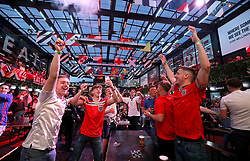 Fans celebrate at the end of the game after watching the UEFA Euro 2020 Group D match between Czech Republic and England at BOXPARK in Croydon. Picture date: Tuesday June 22, 2021.
