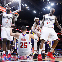 25 November 2015: Los Angeles Clippers forward Lance Stephenson (1), Los Angeles Clippers forward Josh Smith (5) and Los Angeles Clippers guard Jamal Crawford (11) help Los Angeles Clippers guard Austin Rivers (25) to get back on his feet during the Utah Jazz 102-91 victory over the Los Angeles Clippers, at the Staples Center, Los Angeles, California, USA.