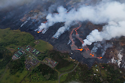 2018 05 24 - Pahoa, Hawaii, USA:  Multiple fissures continue to erupt parallel to the Puna Geothermal Venture facility, with the majority of volume supplying rivers of lava flowing toward the sea, while the formation of cones and increase in elevation of surrounding areas have slowly expanded flows toward the plant.  <br />Photo: ZUMA/Bruce Omori/Paradise Helicopters